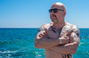 Sea view, bald headed poser. . . (CWhatPhotos) Tags: cwhatphotos cyprus protaras eastern pose shades sunglasses sun look tattoo tattooed bw portrait man male sunny day waters 2018 april digital camera pictures picture image images photo photos foto fotos that have which contain olympus seafront golden coast beach blue sky skies holiday water sea deep color colour 43 micro four thirds penf muscles muscle torso body men