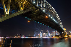 Sydney Harbour Bridge - On the other side of the shiny side (StefanKleynhans) Tags: sydney harbourbridge vivid 2018 milsonspoint architecture bridge structure light rays water harbour ocean river waterway reflection nikond7100 nikon1635f4 australia nsw