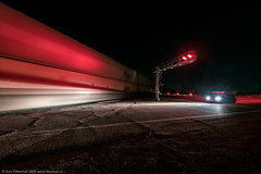 Waiting For A Train (dejavue.us) Tags: railcrossing longexposure d850 nightphotography nikon desert vle train bnsf fullmoon nikkor mojavedesert 140240mmf28 red california railroad