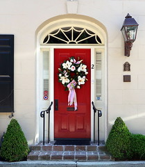 Red door with a magnolia Easter wreath, Bedons Alley, Charleston, SC (Spencer Means) Tags: architecture bedonsalley street broad south below door doorway red wreath magnolia easter charleston sc southcarolina house front arch fanlight lamp lantern light window