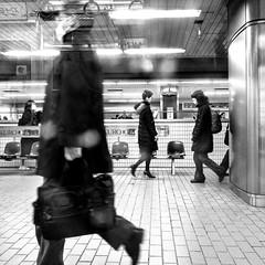 Commuters' Tango (cresting_wave) Tags: iphoneography mobileography iphonephotography mobilephotography streetphotography iphonex procamera snapseed blackwhite monochrome people commuters subway subwaystation subwayplatform citylife walking