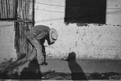 Untitled (Ojo de Piedra) Tags: 35mmfilm nikon window sierraalta blackwhite exploration film hidalgo mexico shadows smalltown adventure negativefilm monochrome travel trix400 anonimous streetphoto manwithhat nikonf100 kodak