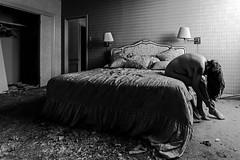As though we were drowning inside our hearts (sadandbeautiful (Sarah)) Tags: me woman female self selfportrait abandoned bedroom abandonedresort bw monochrome pabloneruda