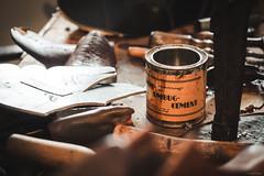 Umbug-Cement - Bramberg, Austria (Sebastian Bayer) Tags: alt handwerk umbugcement bramberg ausflug tisch leder dose arbeit museum historisch schuh urlaub kleber schuhmacher klebstoff detail