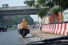 following the postman around the traffic circle (the foreign photographer - ฝรั่งถ่) Tags: postman packages laksi traffic circle bangkhen bangkok thailand nikon d3200