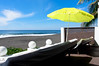 Sunbeds and green umbrella beside the beach (wuestenigel) Tags: view umbrella solarium beach comfortable sunbed relax tropical strand chair stuhl regenschirm travel reise tropisch ocean ozean relaxation entspannung water wasser seashore sea meer sunshade sonnenschirm island insel sand vacation ferien sofa summer sommer noperson keineperson resort erholungsort exotic exotisch idyllic idyllisch