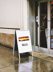 Grilled Cheese (Demmer S) Tags: street building streetphotography shootthestreet streetshots documentary citylife urban city outside urbanphotography streetscene urbanexploration text billboard sign ad word hello type typography caps letters design graphicdesign photo image graphic photography photograph food lunch bread grilledcheese grilled cheese sandwich advertisement restaurant signage retail signs poster display advertise marketing advertising business visual minimal minimalism minimalist minimalistic simplicity rainyday rain wetpavement raining door outdoors exterior sidewalk entrance persuasive eyecatching witty effective imagery promotional informational specific product simple simplistic
