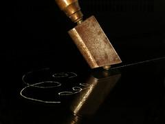 Glass cutter (CHRISCARMA) Tags: nikone4500 diamond glass cutter lowkey blackbackground closeup scratch metal brass coolpix macro reflections tip vivitar283 flash illumination line black