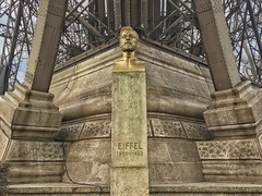 Paris  France - Bust of Gustave Eiffel at the Base of The Eiffel Tower (Onasill ~ Bill Badzo) Tags: memorial paris france europe base gustaveeiffel eiffel tower monument landmark historic night photo iphonegraphy iphone onasill champ de mars sexy enigineer built architecture style worlds fair artist global cultural icon world travel tourist mustsee parisian french history masterpiece revolution centennial sky clouds blue entrance quartier saint germain art bridge park road grass tree