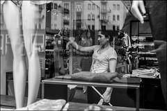 0m2_DSC6369 (dmitryzhkov) Tags: russia moscow documentary street life human monochrome reportage social public urban city photojournalism streetphotography people bw dmitryryzhkov blackandwhite everyday candid stranger worker job work employee face streetportrait portrait pretty woman reflection glass vendor trade