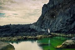 Secret place (Rita Eberle-Wessner) Tags: landschaft landscape lapalma klippen kliff cliffs felsen rocks wasser water stones steine frau woman weiseskleid whitedress berg turquoisewater lava lavastones