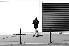 Looking over his shoulder (pascalcolin1) Tags: paris13 homme man mur wall lumière light cigarette ombre shadow chapeau hat photoderue streetview urbanarte noiretblanc blackandwhite photopascalcolin canon50mm canon 50mm