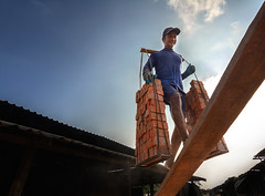 All the way up! (2MilkyWay) Tags: thailand work hot labour blue bricks physical sun smile happiness countryside outdoors factory ayutthaya earth soil lifting life hard climbing balance clouds loading truck sky summer wood light
