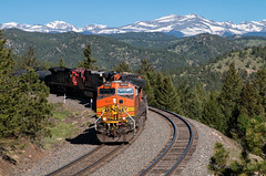 Crescent Views (Wheelnrail) Tags: bnsf burlington northern santa fe ge c449w hpvoden union pacific up railroad rail road moffat tunnel subdivision rocky mountains snow cap peaks train trains locomotive tree forest mountain car landscape sky grass