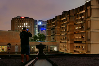 A Montreal Urban Explorer Taking in Rooftop View at Night