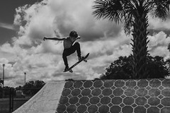 Ride Like the Wind (cmh photographs) Tags: skateboard skating zephyrhills florida monday skate park air wind ride riding skatepark black white blackandwhite grain grainy palmtree clouds sky skies fly flying wall afternoon jump jumping skateboarding