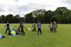 Historia Normannis Meadows June 2018-730 (Philip Gillespie) Tags: historia normannis central scotland sparring fighting shields swords axes spears park grass canon 5dsr men man women woman kids boys girls arms feet hands faces heads legs shins running outdoor tabards chain mail chainmail helmets hats glasses sun clouds sky teams solo dead act acting colour color blue green red yellow orange white black hair practice open tutorial defending attacking volunteer amateur kneeling fallen down jumping pretty athletic activity hit punch