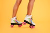 Cropped image of women legs wearing colorgul rollers (ObserverXtra) Tags: adult attractive background beach beautiful beauty bikini orange body copyspace fashion female girl isolated lifestyle modern one outfit people person relax standing style stylish summer swimsuit wearing woman young youth rollers skates posing cropped image roller june 21 2018 observer