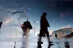 Paris, Place de la Bastille et son Opera (Calinore) Tags: street city paris france reflection water rain silhouette puddle opera eau expo pluie reflet bastille iledefrance marche ville miror homme flaque marcher 11eme reflectionof ecenter colonnemorris xieme onzieme 11emearrondissement gtest exposoff variationssurlesmondesinverses selectionneespargetty