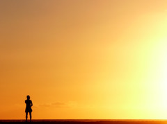 A Man on a Journey (sgrazied) Tags: sunset orange beautiful silhouette lumix fz20 spain tour background 2006 silouette human journey fullhouse shape spagna tarifa massi 1mill fivestarsgallery sgrazied interphoto abigfave 5for2 impressedbeauty superaplus aplusphoto superhearts krishlikesit mcb1030 mcb1604 dp1004