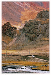 The Crossing (exhibitj) Tags: red terrain mountains river landscape crossing pass 4wd tibet rough landcruiser advertisment pinkish 1870 kharila