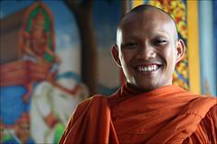 Khmer Smile: Samuth (mboogiedown) Tags: travel orange man smile asian temple pagoda interestingness colorful asia cambodia cambodian khmer bokeh buddhist south faith religion culture belief monk buddhism east spirituality southeast tradition vat wat monastic battambang sangha robes theface dhamma savana kampuchea phum mapcambodia cambogia interestingness181 khmersmile i500 thegoldenland bokehphotooftheday bokehlicious camboge bokehsoniceseptember colorsofcambodia beatravelernotatourist itsallaboutthepeople 91106 samuth theravda savanaphum bokehsoniceseptember16 livingfaith ifthephotographerisinterestedinthepeopleinfrontofhislensandifheiscompassionateitsalreadyalottheinstrumentisnotthecamerabutthephotographer~evearnold alljourneyshaveasecretdestinationofwhichthetravelerisunawaremartinburber