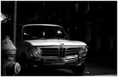 Old BMW & Hydrant (paul drzal) Tags: street blackandwhite hydrant nighttime bmw philly northernliberties cityatnight phillyist philadelphiaatnight lightsphiladelphia nightphilly nighttimephiladelphia nightphiladelphia philadelphiainthedark urbannightimages