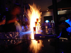 Flaming Shots (JaulaDeArdilla) Tags: barcelona 2005 light espaa bar fire cuisine spain espanha shot drink llama catalonia flame liquor alcohol nightlight catalunya nightlife fuego espagne catalua spanien spagna spanje bebida spania  flama  foc espanya licor chupito  beguda hiszpania xarrup tybannha