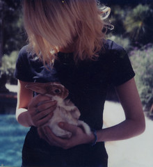 Cami and Dunston (grandylion) Tags: friends rabbit bunny polaroid sx70 la polaroids cami hold dunston