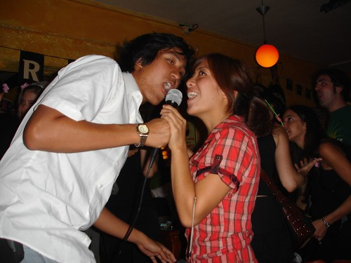 two people having fun singing karaoke