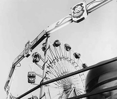 Tilt a Whirl (Oldvidhead) Tags: carnival blackandwhite bw speed amusement nikon amusementpark rides tiltawhirl nikondigital thrill ericlarson oldvidhead elarson