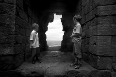 Double Gazing (Ray Byrne) Tags: blackandwhite bw castle window stone monotone northumberland nationaltrust dunstanburgh dunstanburghcastle raybyrne byrneout byrneoutcouk webnorthcouk