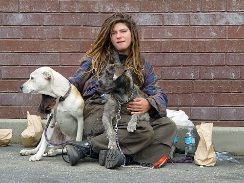 Homeless woman with dogs by Franco Folini.
