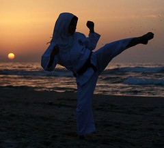 A #Palestinian #girl trains on the martial #art #karate on the #beach in #Gaza city. (TeamPalestina) Tags: dailylife night light instagram freepalestine palestinian sunrise sweet beautiful heritage live photo photographer comfort natural تصويري palestine amazing innocent occupation landscape landscapes reflection blockade hope canon nikon