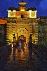 Mdina City Gate (Douguerreotype) Tags: gameofthrones blue door dark stone light malta gate architecture gold reflection city night fort historic
