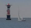 A Hallberg-Rassy 44 and the Viken lighthouse (frankmh) Tags: yacht boat sail sailing lighthouse viken skåne sweden