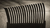 Bending verticals (citrusjig) Tags: fujifilm xe1 tamron75250mmf3845adaptall2104a shadow vertical bread slicer kraft paper curl blackandwhite toned dailyinapril