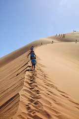 Follow the leader. (DH20) Tags: sun sand dunes namibia sky climb active hiking canon eos450d sossusvlei