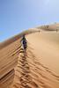 Follow the leader. (DH20) Tags: sun sand dunes namibia sky climb active hiking canon eos450d sossusvlei