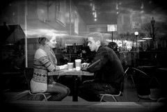 View from the sidewalk-two lovers L1040140-002 (LarryJ47) Tags: leicax1 fixed lens man woman lovers coffee shop bw black white storefront window romance