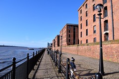 A matter of perspective (flowergirlaaa) Tags: liverpool merseyside waterfront path perspective point brick cobbles architecture boy railings wall water blue red 7dwf cityscape landscape lovelocks boat river block warehouses victorian shadows