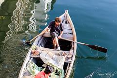 Boat in Pichola (PB1_0858) (Param-Roving-Photog) Tags: boat boatman oar rowing ripples water reflection lake pichola udaipur morning chandpole bridge streetphotography travel rajasthan incredibleindia vibrant colours naturallight nikond750 nikkor70300