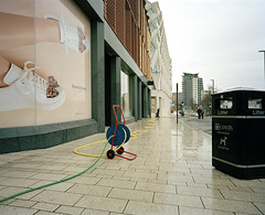 LEEDS STREET PHOTOGRAPHY (Tyrone Fleming) Tags: colorflm filmphotography gwtphotography ilovefilm ishootfilm outdoor kodakportra400 portra400 pavementcleaning hoses cleaningthepavement buildings leedscitycentre shotonfilm streetphotography literbin people tyronefleming johnlewis
