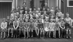 Class photo (theirhistory) Tags: children boys kids class form school teacher hat coat dress shoes girl jumper wellies rubberboots