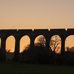 Coal train crossing Porthkerry Viaduct, south Wales, at sunset thumbnail