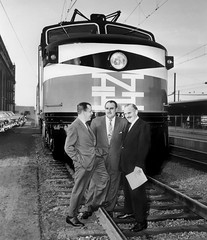 New Haven Railroad GE EP-5 Motor # 375, is seen shortly after recent acceptance by Patrick McGinnis and some of the railroad's executive brain trust at New Haven Union Station, ca 1955 (alcomike43) Tags: newhavenrailroad newyorknewhavenhartfordrailroadcompany newhavenunionstation station depot newhavenconnecticut executives employees braintrust patrickmcginnis locomotive engine notor electricengine electriclocomotive 375 ge generalelectric ep5 jet cc pantograph electrification catenary railrs ties roadbed ballast tracks siding rightofway platform platformcanopy building people photo photograph bw blackandwhite old historic vintage classic