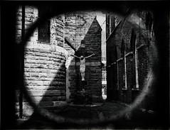 (GLKPhotos) Tags: church gate cruciform crucifiction jesus jesuschrist christ saviour cross churchyard saintpatricksromancatholicchurch inri stonemasonry stone circular window stainedglass lightandshade shadows blurred depthoffield contrast tonalcontrast blackandwhite bw mono monochrome statue panasonic lumix gx8 25mm f17 cityofbelfast belfast northernireland city