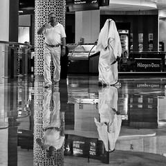 East meets West! (DepictingPhotos) Tags: dubai reflections shops white black