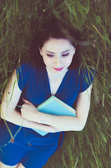 Nonostante Me (Michela Riva Photography) Tags: reading girl woman blue dress pale skin meadow grass dreaming daydream romantic portrait smile female outdoor travel relax quiet peace people thinking book porcelain brunette green caucasian italy serenity peaceful dreamer read