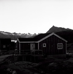 Kuummiit sunset (Úlfur Björnsson) Tags: bw black white medium format film 6x6 mamiya 80mm f28 sekor ilford hp5 plus 400 120 analog houses greenland trip travel dusk sunset kuummiit house
